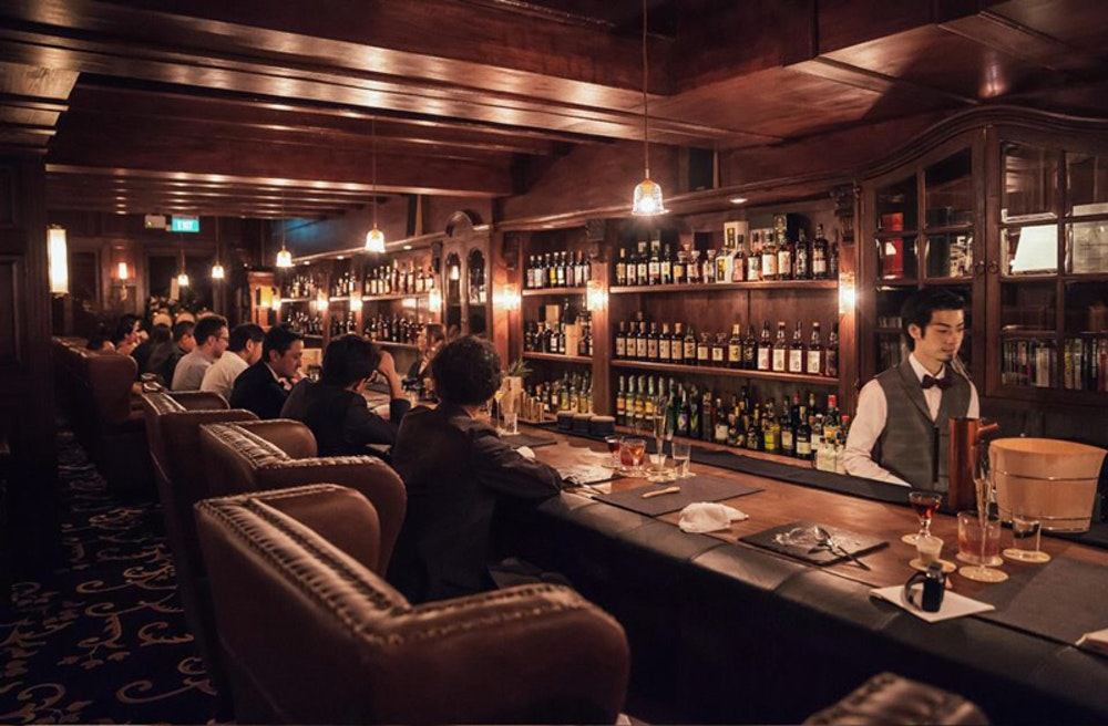 D Bespoke customers at bar in leather chairs