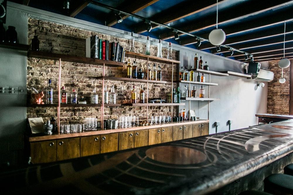 Native bar light bar with bottles on back